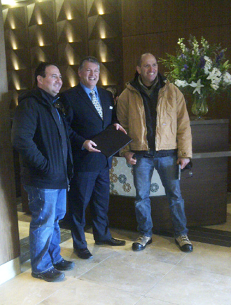 First DoubleTree by Hilton Hotel and Conference Centre Regina Guests, David Adler (left) and Rick Swanson (right) pictured here with General Manager, Mike Wurster.